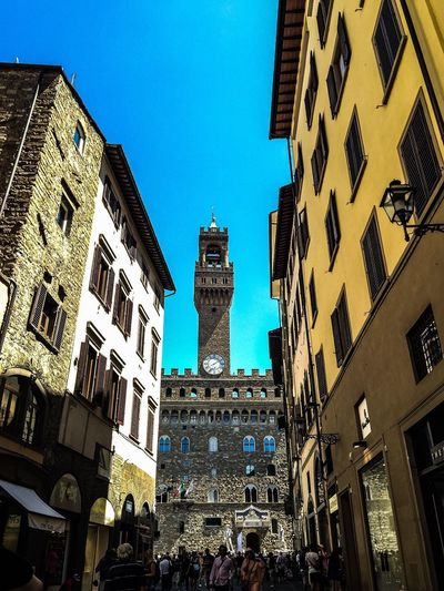 Architecture Building Exterior Built Structure Low Angle View City Travel Destinations Clear Sky Sky Outdoors Day Statue Large Group Of People Cultures Astronomical Clock