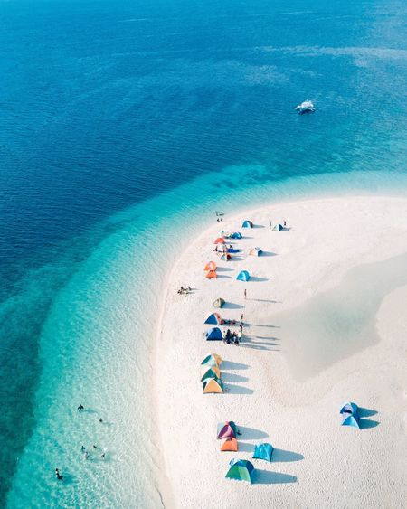 Camping in Moalboal Sea Blue Water Land Sand Beach Nature High Angle View Sunlight Day Travel Aerial View People Vacations Leisure Activity Lifestyles Holiday Beauty In Nature Trip Turquoise Colored