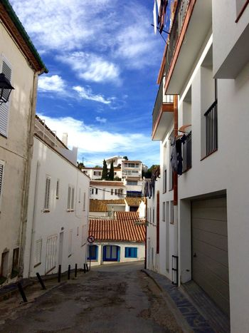 in love with this city Breathing Space Cadaqués Relaxing SPAIN Spanish Typical Washing Architecture Building Exterior Built Structure City Cloud - Sky House No People Outdoors Residential Building Sky Street Sun Town Travel Destinations White Architecture White House Windows