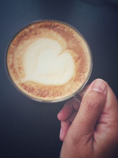 Drink Frothy Drink Human Hand Coffee Cup Coffee - Drink Cappuccino Food And Drink Refreshment Holding Latte Close-up Froth One Person Table Freshness