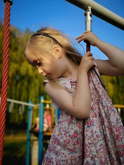 Low section of girl on playground