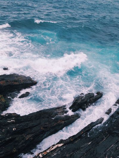This rainy weather makes the color of the sea even more beautiful Sea Waves Rocky