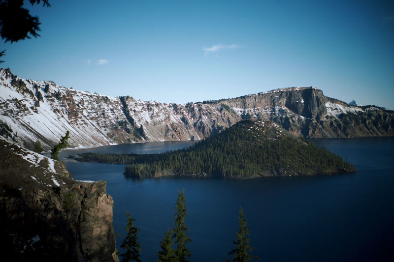 Crater Lake Tourist Attraction  Travel Beauty In Nature Blue Cliff Formation Idyllic Lake Mountain Nature No People Non-urban Scene Outdoors Remote Rock Rock Formation Scenics - Nature Sky Tranquil Scene Tranquility Volcanic Lake Volcano Water Waterfront