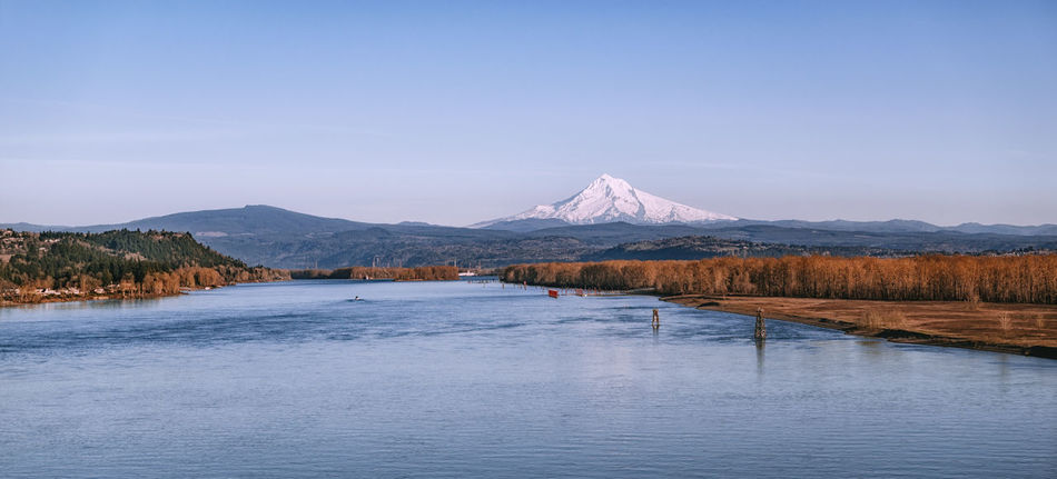 Mount Hood, Columbia river. Near Portland, Oregon, USA Autumn Columbia River Mount Hood Oregon Portland USA Beauty In Nature Idyllic Mountain Mountain Peak No People Outdoors River Scenics - Nature Sky Snow Snowcapped Mountain Tranquil Scene Tranquility Water Waterfront White Peak