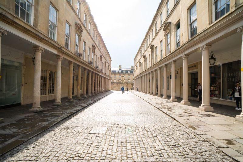 Cobblestone Street Amidst Buildings