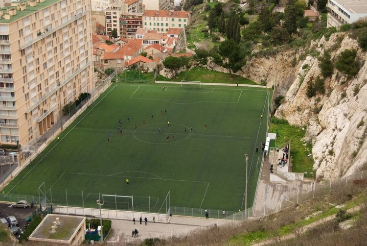 High angle view of soccer field by building