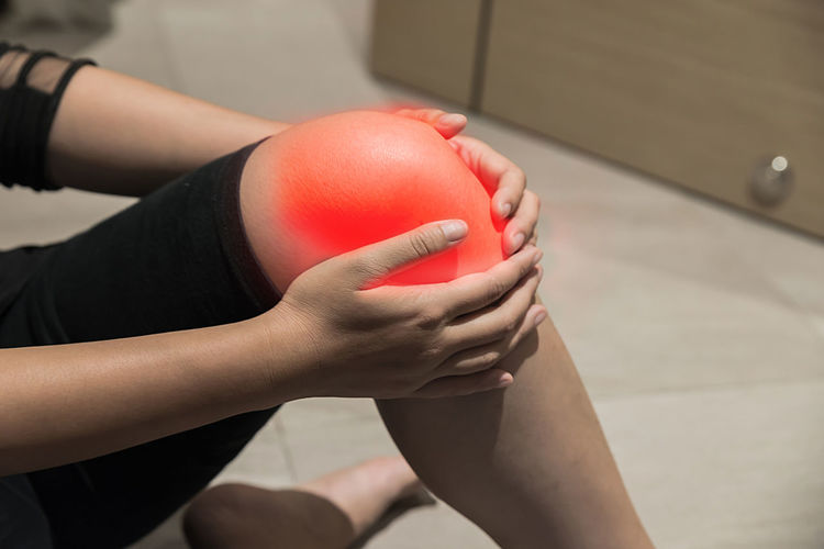 Adult Ball Body Part Close-up Finger Focus On Foreground Hand High Angle View Holding Human Body Part Human Hand Human Leg Human Limb Indoors  Leisure Activity Lifestyles Midsection One Person Real People Red Women