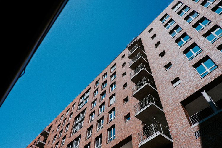 Architecture Balcony Brick Building Exterior Built Structure City Clear Sky Day Landmark Loft Low Angle View Maritime Modern No People Outdoors Silo Window Windows