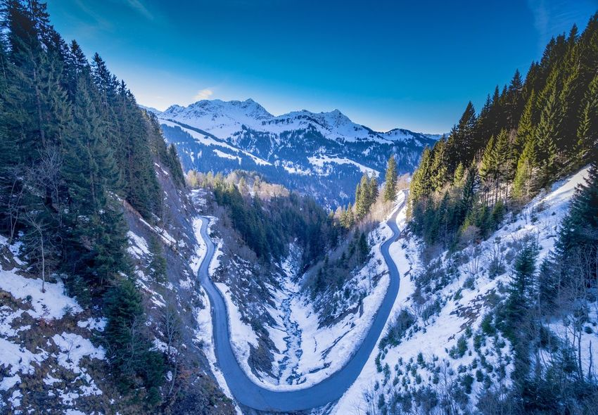 Aint no Mountain high Aerial View Drone  EyeEm Selects Mountain Beauty In Nature Scenics Nature Tranquil Scene Tranquility Winter Snow Mountain Range Outdoors Cold Temperature Winding Road Blue Day Sky No People Tree Landscape Shades Of Winter Shades Of Winter