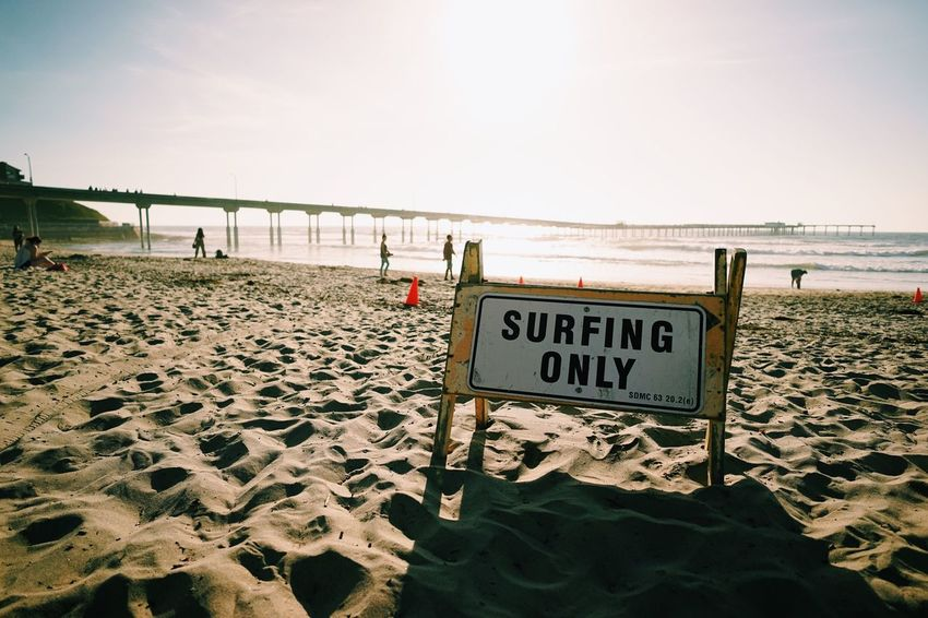 Surfing only // Sea Beach Water Text Horizon Over Water Tranquil Scene Scenics Nature Tranquility Communication Sky Clear Sky Sand Day Outdoors Beauty In Nature No People