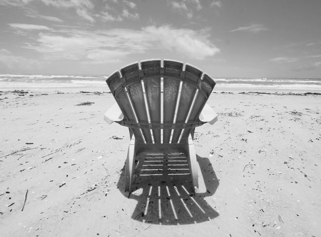 first eyeem photo Be. Ready. Carefree Relax Sand Beach Black And White Gulfcoast Florida Kick Back Stressfree Retirement Beach Life Retire Beach Chair Adirondack Chairs EyeEmNewHere