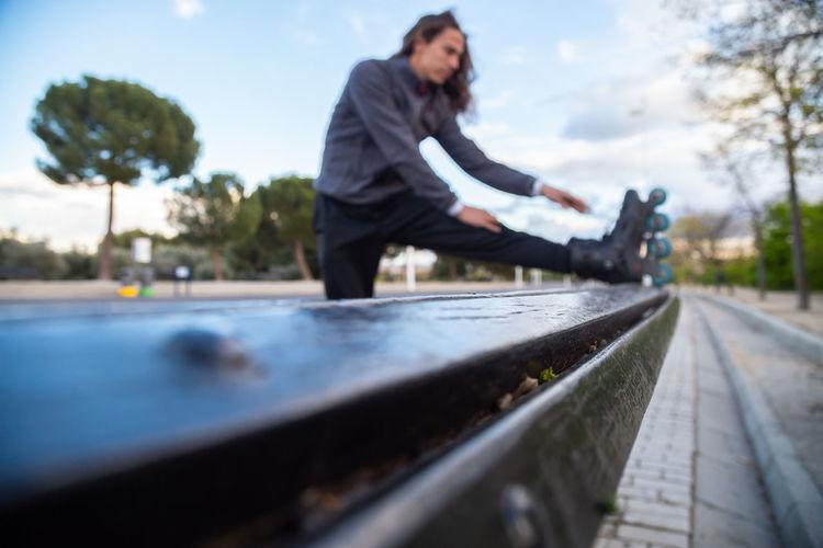 Full length of woman on railroad tracks against sky