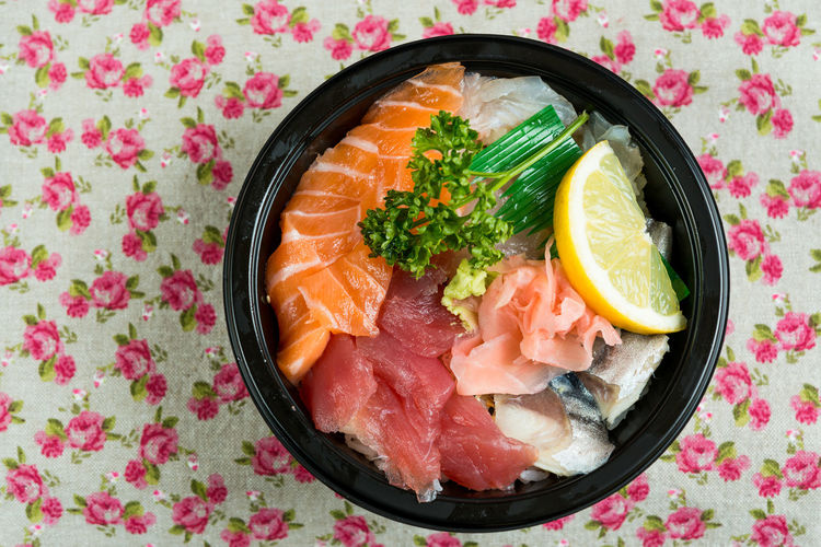 Directly above of chirashi served in bowl on table