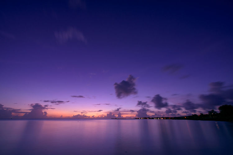 Island with natural beauty Beauty In Nature Blue Cloud - Sky Dusk Idyllic Illuminated Light Nature Night No People Outdoors Purple Reflection Scenics - Nature Sea Sky Sunset Tranquil Scene Tranquility Twilight Water