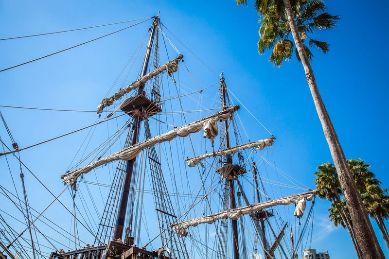 Low Angle View Of Sail Ship Masts Against Clear Blue Sky