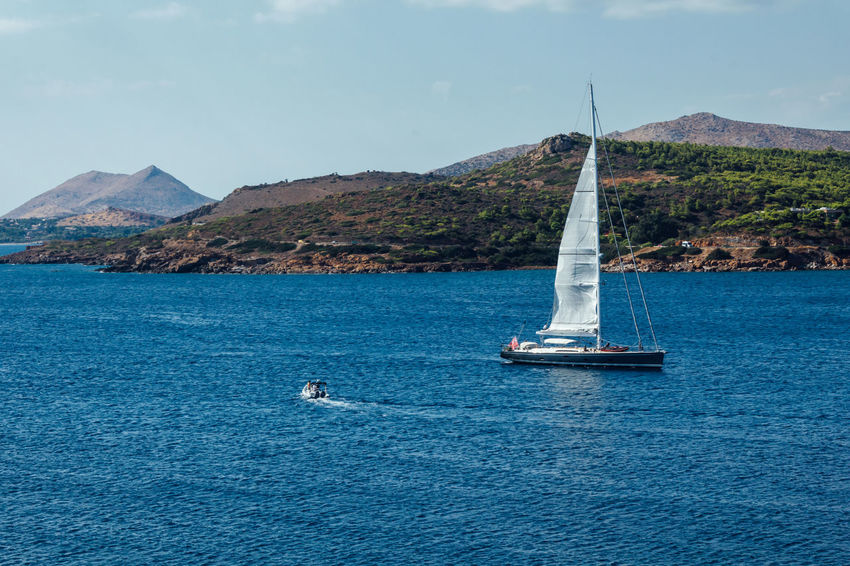 Cape Sounion Beauty In Nature Blue Boat Cape Sounion Great Outdoors With Adobe Lifestyles Mode Of Transport Mountain Nature Nautical Vessel Outdoors Remote Rippled Sailboat Sailing Scenics Sea Sounion Tranquil Scene Tranquility Travel Water Waterfront