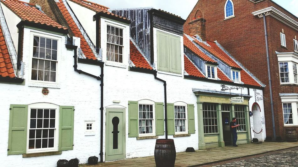 Architecture Building Exterior Built Structure Window Outdoors Day Travel Destinations Scenics Quayside Harbour View Harbour Historic Museum Shops Whitewashed Walls Dockside View