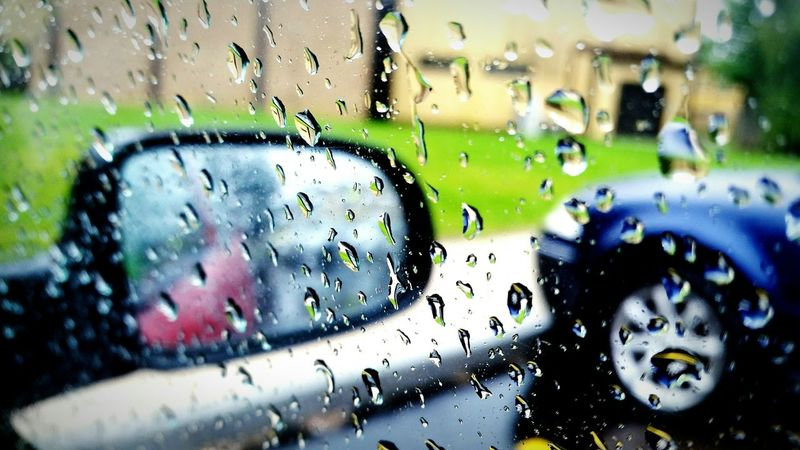 Taking shelter from the storm. Storm Approaching Hiding Out Trapped In My Car Focus_graphy Rain Drops Raining Outside Water Reflections Watching Rain Drops The EyeEm Facebook Cover Challenge Eyeem Raining