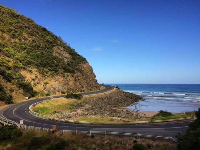 Great Ocean Road Beach Beauty In Nature Blue Clear Sky Day Horizon Over Water Mountain Nature No People Outdoors Road Road Trip Scenics Sea Sky Tranquil Scene Tranquility Transportation Tree Water Winding Road
