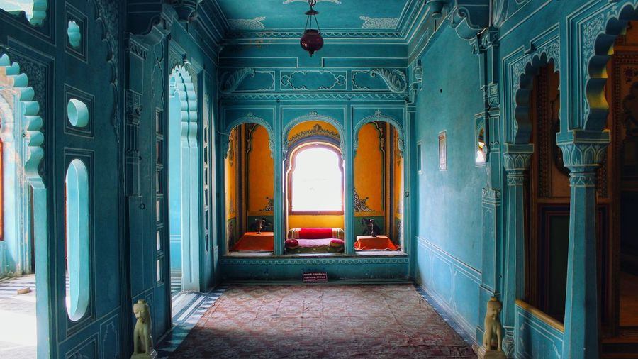King's room in City palace Interior Udaipur Rajasthan India Photography EyeEm Selects Vivid Cultures Artandculture Blue Turquoise Colored Window Rajasthani Bed Vibrant Color Orange Sunlight Multi Colored Arts Culture And Entertainment Arch Architecture Historic Passageway Civilization Architectural Column Carving - Craft Product