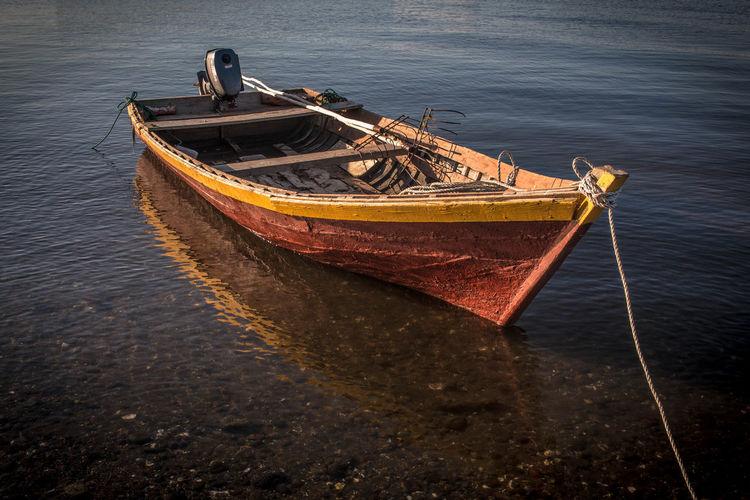 Fishing boat moored at sea shore