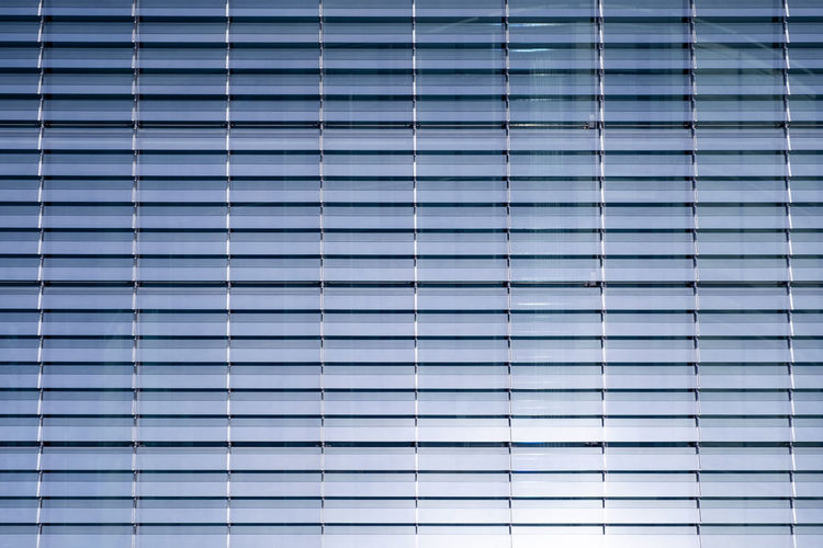 Copy Space Reflection Sunlight Abstract Architecture Backgrounds Blinds Blue Building Exterior Built Structure Close-up Day Full Frame In A Row Metallic No People Order Pattern Repetition Safety Security Striped Textured  Wall - Building Feature Window