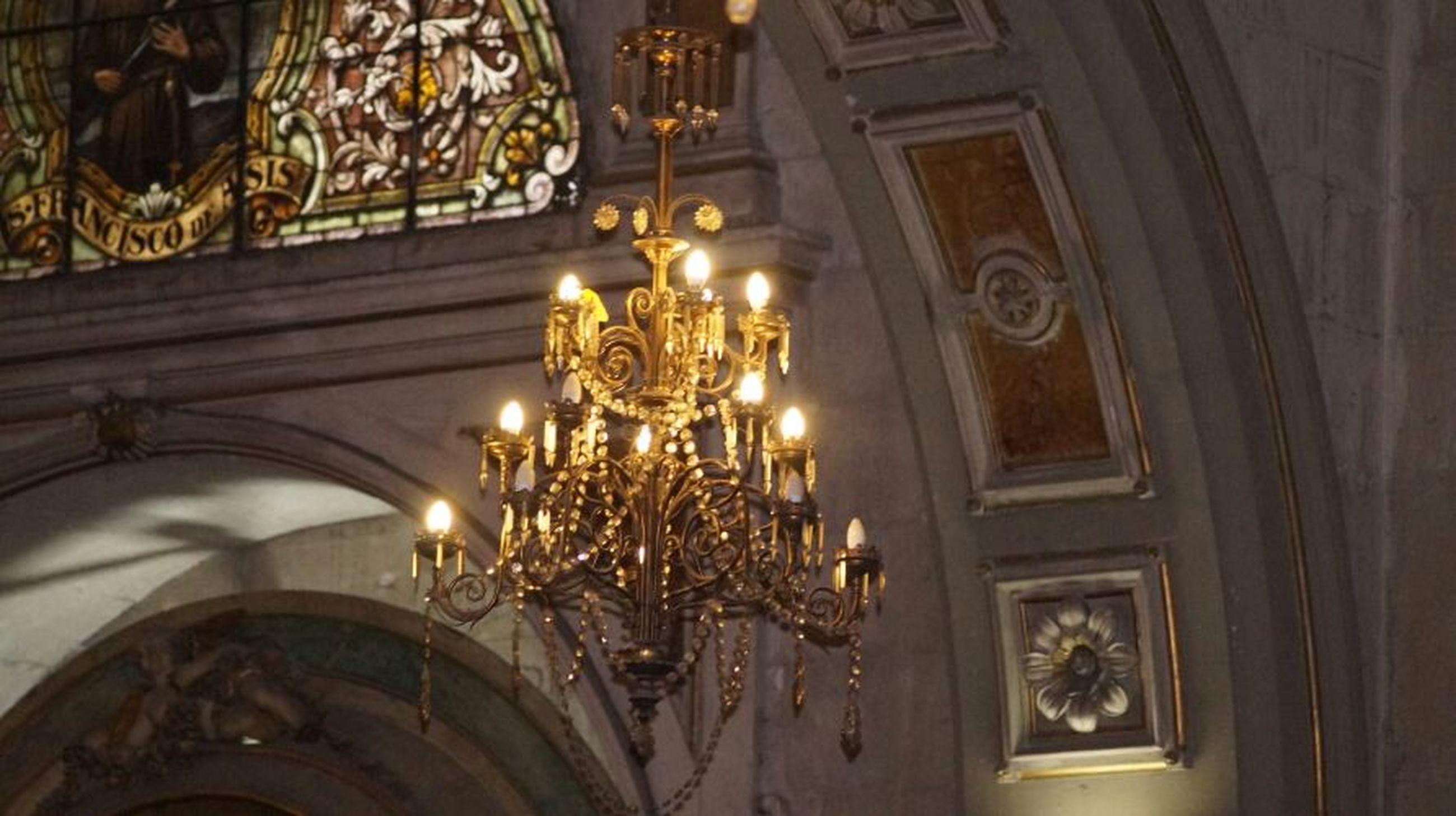 indoors, architecture, built structure, low angle view, illuminated, ceiling, ornate, lighting equipment, chandelier, decoration, hanging, place of worship, religion, design, church, building exterior, window, no people, architectural feature