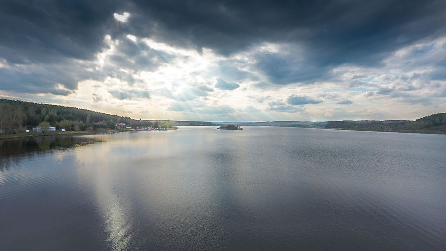 Sun light breaking through dark clouds over a water reservoir (Zalew Brodzki, Poland) Beauty In Nature Cloud - Sky Day Fly High☁☁☁ Idyllic Lake Mountain Nature No People Outdoors Reflection Scenics Sky Tranquil Scene Tranquility Water Waterfront