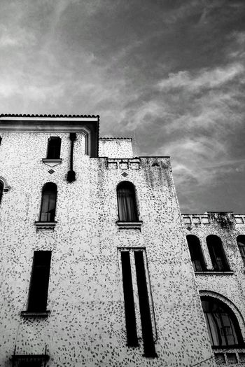 Old windows Black & White Architecture Building Exterior Built Structure Cloud - Sky Day Façade History Low Angle View No People Old The Past Window