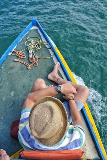 High angle view of man lying on boat