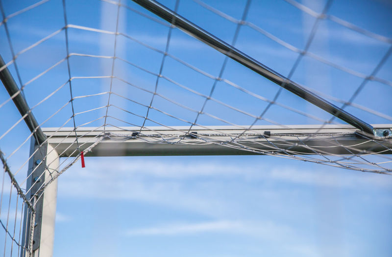 Low Angle View Of Net Against Blue Sky