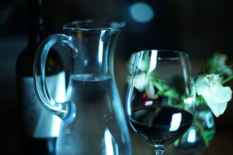 Close-Up Of Wineglass And Jug