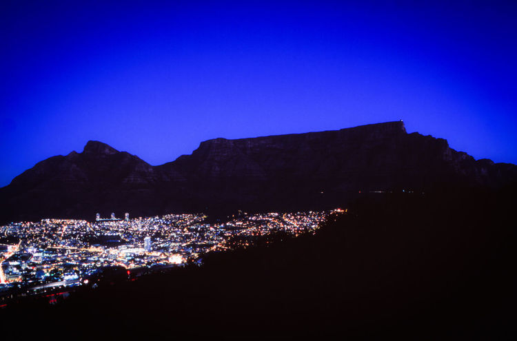 The view from signal Hill overlooking Table Mountain Just after Sunset. Long Exposure shot on Slide Film. Analogue Photography Film Is Not Dead Beauty In Nature Blue Building Exterior Built Structure Capetown City Cityscape Clear Sky Film Photography Illuminated Landscape Long Exposure Mediumformat Mountain Nature Night No People Nofilter Outdoors Sky Slidefilm Tablemountain Tree