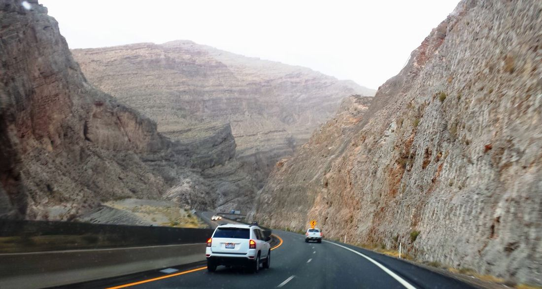 On the road passing through Arizona Arizona Arizona Sky Beauty In Nature Cliff Journey Mountain Mountain Range Mountain Road Nature Non-urban Scene On The Move Outdoors Physical Geography Road Road Trip Road Trippin It! Road Trippin' Roadtrip Rock Formation Rocky Scenics Travel
