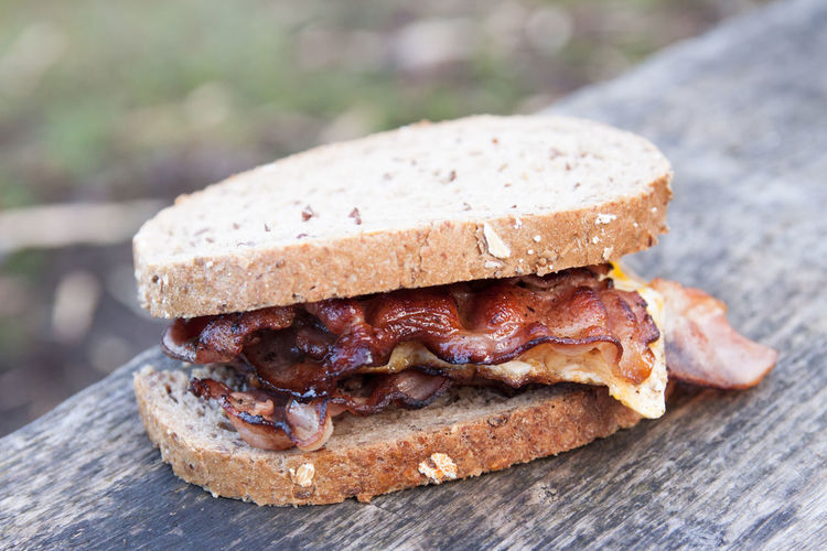A real breakfast by the campfire! Bacon Bread Close-up Food Food And Drink Freshness No People Outdoors Ready-to-eat Sandwich SLICE Travel Trekking Wood - Material