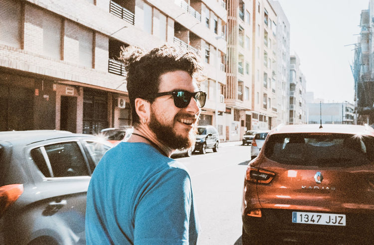 Architecture Building Exterior Built Structure Car City Glasses Land Vehicle Lifestyles Men Mode Of Transportation Motor Vehicle One Person Outdoors Portrait Real People Street Sunglasses Transportation Young Adult Young Men
