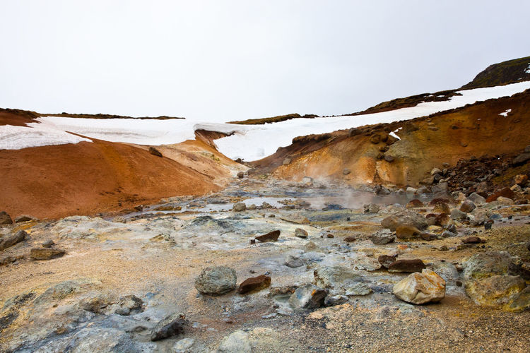 Geothermal landscape against clear sky during winter at seltun