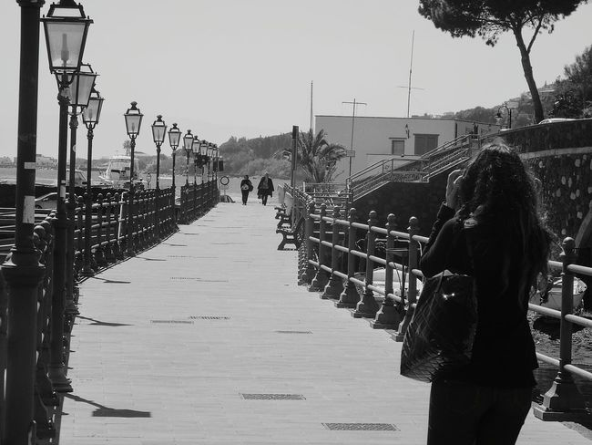 Monochrome Photography TakeoverContrast Lipari, Landscape Lipari Lipari Island Eolian Islands Eolianisland Eolie Islands Girl Clear Sky Casual Clothing Person Day Walkway Outdoors Sky Light And Shadow Sea Sea And Sky Rear View Horizon Over Water Water Travel Vacations Beach