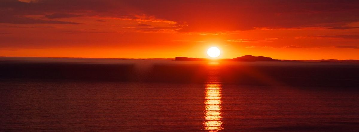 Sunset on the Isle of Mull. EyeMeNewHere Western Isles Scotland Isle Of Mull Sunset Sun Orange Color Beauty In Nature Scenics Nature Sea Tranquility Water Horizon Over Water EyeEmNewHere EyeEmNewHere