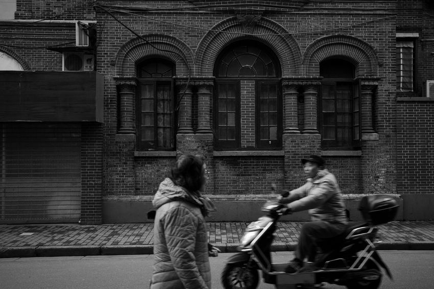 Architecture Building Exterior Built Structure Real People City Street Transportation Women Lifestyles Men Adult People Mode Of Transportation Leisure Activity Building City Life Day Motion Blackandwhite Streetphotography