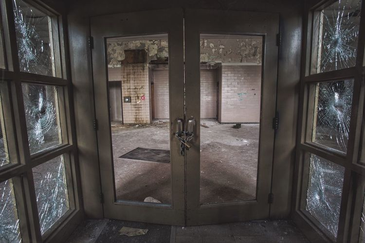 Abandoned interior with closed doors