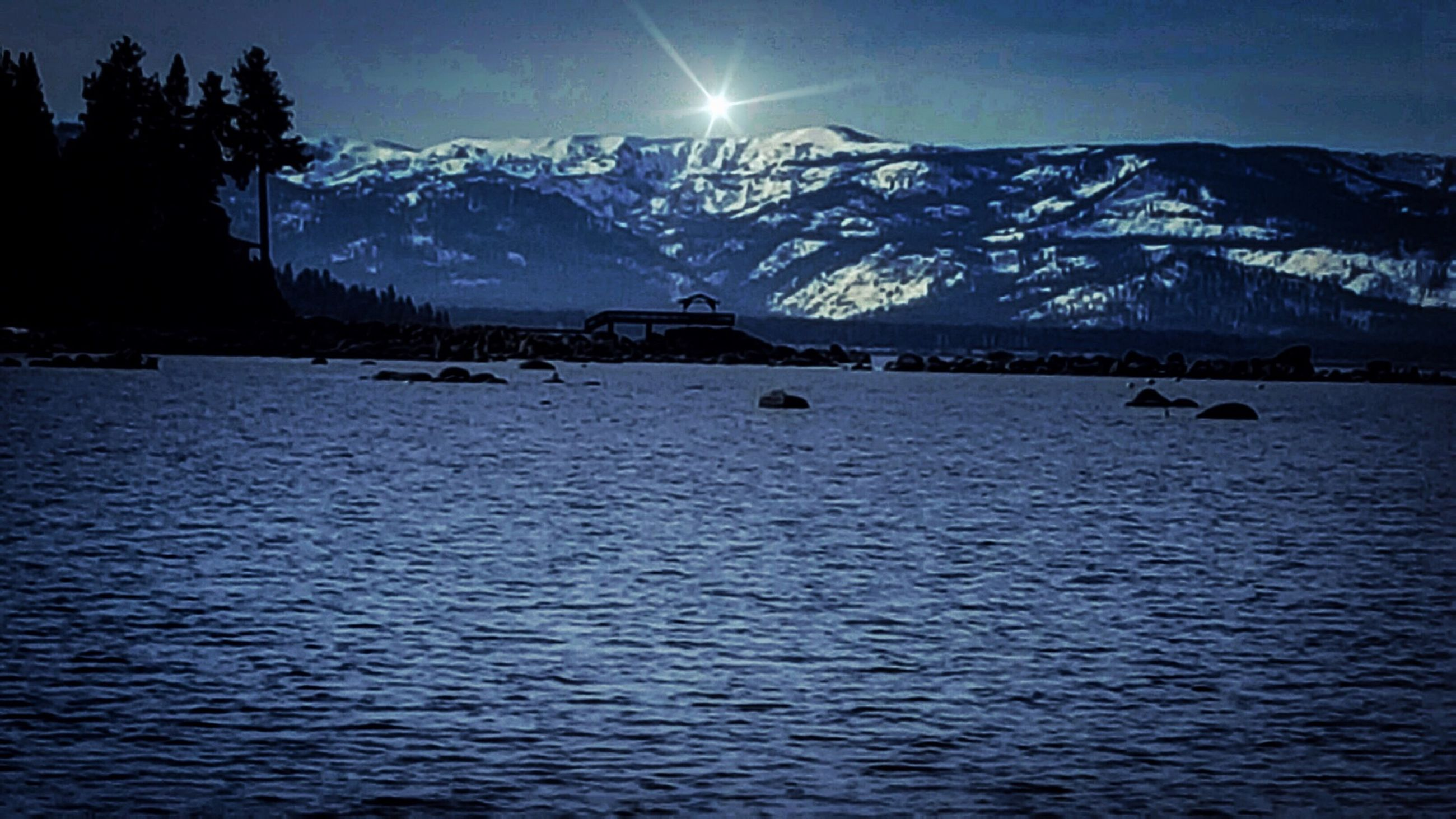 mountain, mountain range, snow, winter, water, cold temperature, tranquil scene, tranquility, scenics, waterfront, beauty in nature, lake, sky, nature, snowcapped mountain, season, rippled, idyllic, reflection, sunlight