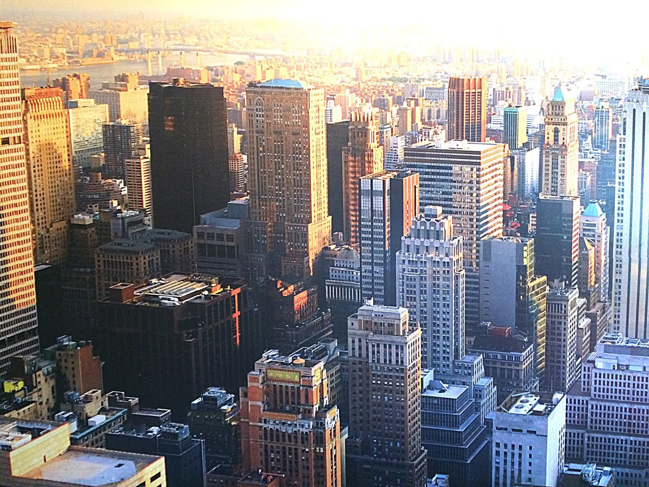 skyscraper, cityscape, architecture, building exterior, city, crowded, development, built structure, modern, urban skyline, travel destinations, high angle view, downtown district, outdoors, sunset, growth, day, illuminated, sky