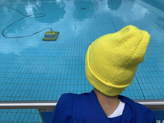 Midsection of woman in swimming pool