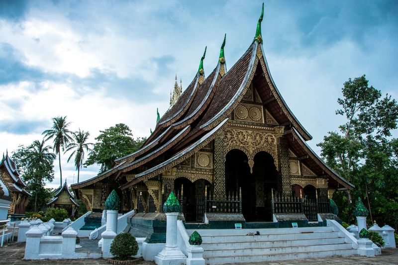 Wat Xienthong Architecture Buddhism Buddhist Temple Day Laos No People Outdoors Place Of Worship Sky Travel Destinations Tree Wat Xieng Thong