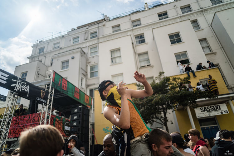 Notting Hill Carnival 2016 Building Exterior Built Structure City City Life City Street Crowd Holding Large Group Of People Leisure Activity Lifestyles Men Outdoors Performance Person Sky Street