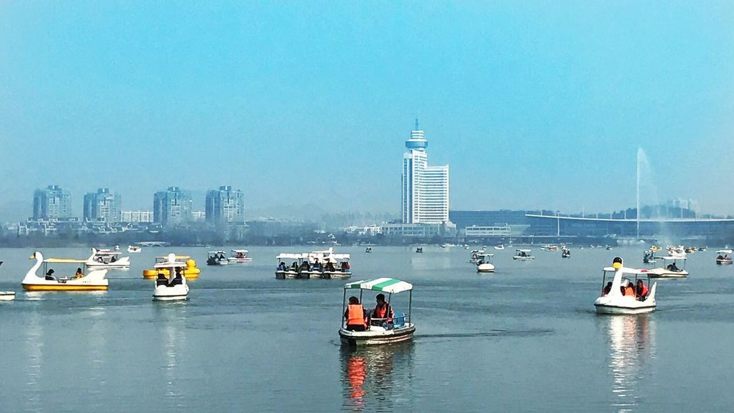 Transportation Nautical Vessel Mode Of Transport Travel Destinations City Water Outdoors Real People Building Exterior Day Tower Waterfront Sailing Architecture Passenger Craft Urban Skyline Wake - Water Ferry Cityscape