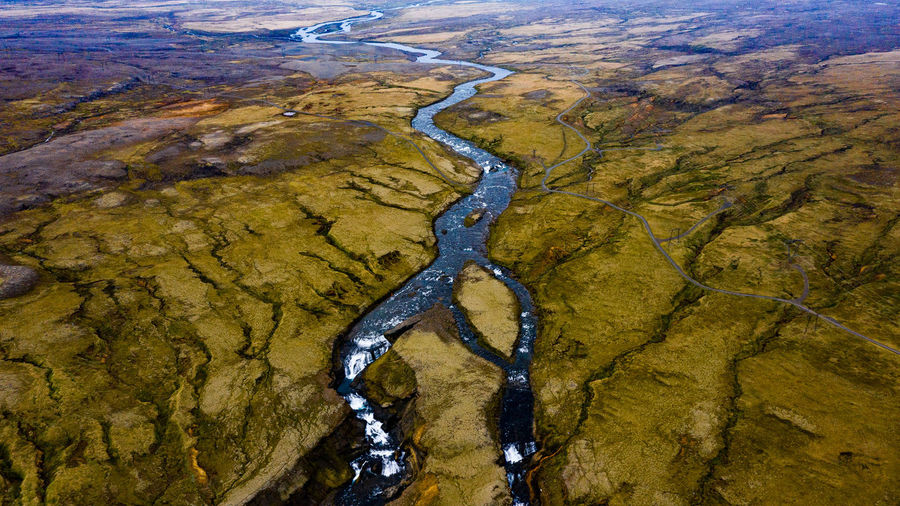 Aerial view of stream amidst land