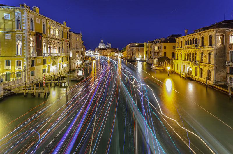 Light trails on illuminated city against clear sky at night, ponte dell'accademia by night