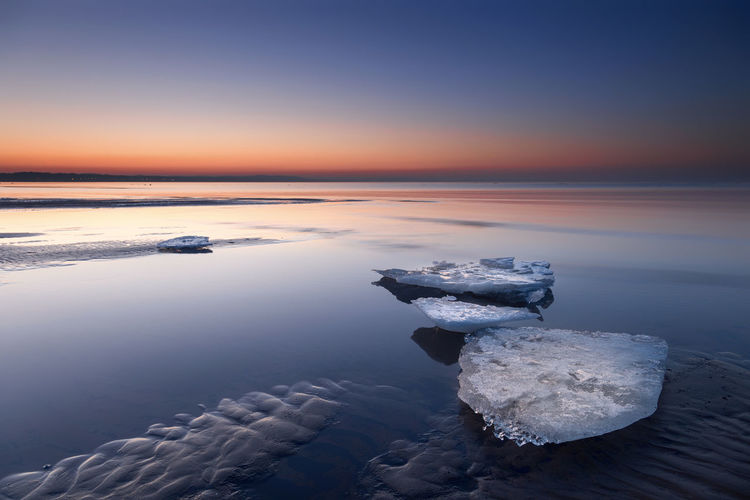 Baltic Sea Ice Beach Beauty In Nature Cold Temperature Day Horizon Over Water Ice Icy Idyllic Nature No People Ocean Outdoors Salt - Mineral Scenics Sea Season  Sky Skyscraper Sunset Tranquil Scene Tranquility Water Winter